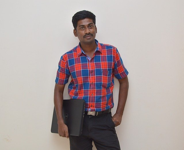 A person standing posing for the camera