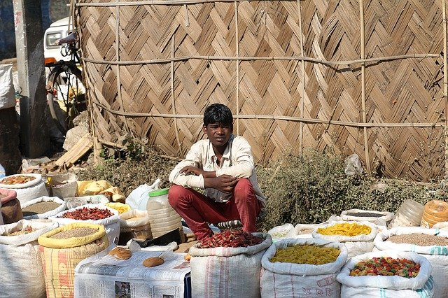 A person sitting at a table full of food