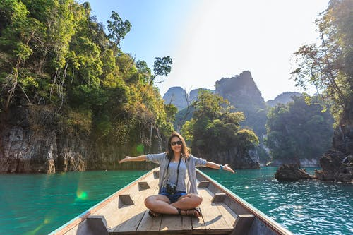 A person sitting in a boat on a body of water